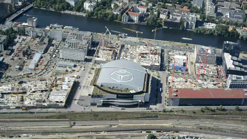 Construction site area of Mercedes-Benz-Arena on the Spree riverbank in the Friedrichshain part of Berlin. The former O2 World - now Mercedes-Benz-Arena - is located in the 'Anschutz Areal', a business and office space on the riverbank