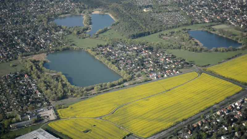 Blooming yellow rape fields to the chain of lakes along the federal road B1 in Mahlsdorf district of Berlin,