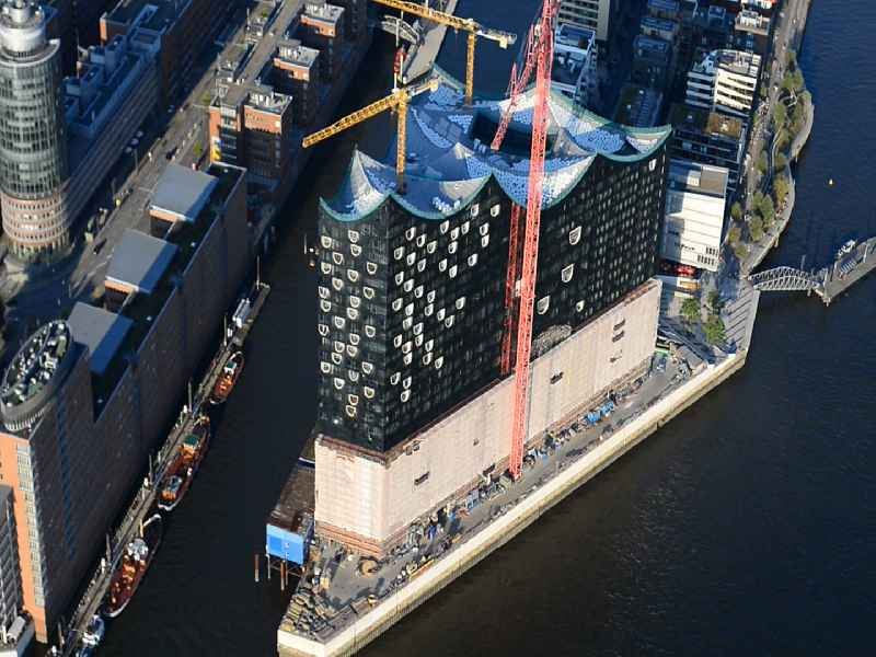 Construction site of the Elbe Philharmonic Hall on the banks of the Elbe in the warehouse district of Hamburg