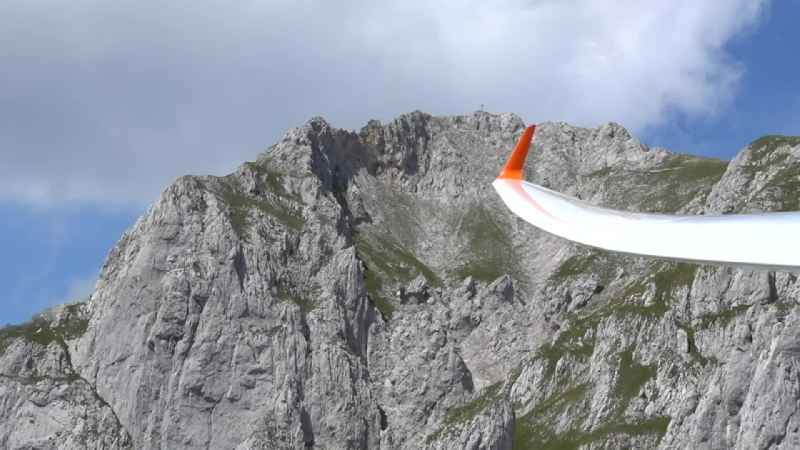 Flyby on the rock and mountain landscape at the 'Wilder Kaiser' in the Kaisergebirge in Kufstein in Tyrol, Austria.
